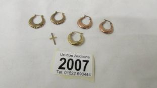 2 pairs of 9ct gold earrings, a single earring and a tiny gold cross, 3.5 grams.