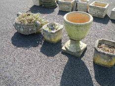 Four old garden pots.