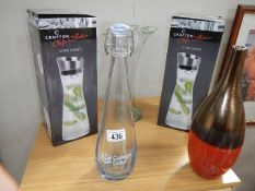 2 boxed carafes and 3 other items of glass ware.