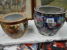Two small hand painted Chinese fish bowls with interior painted fish.