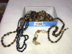 A mixed lot of coloured stone necklaces
