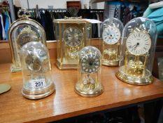 Six assorted clocks including anniversary.