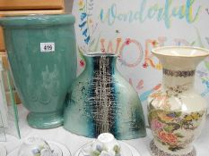 Three vases including one designer.