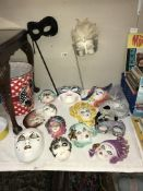 A quantity of ornamental pottery & other face masks