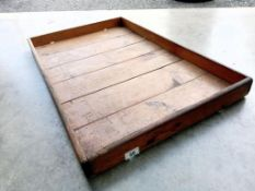A large wooden tray