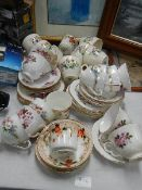 A mixed lot of tea cups and saucers.