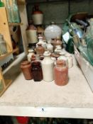 A collection of glazed/named jugs & pots