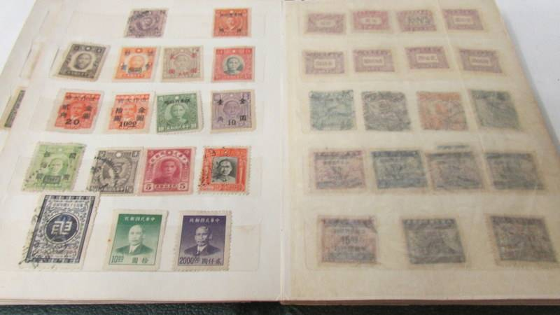 Two small albums of world stamps including India, China, Canada, UK etc. - Image 5 of 14