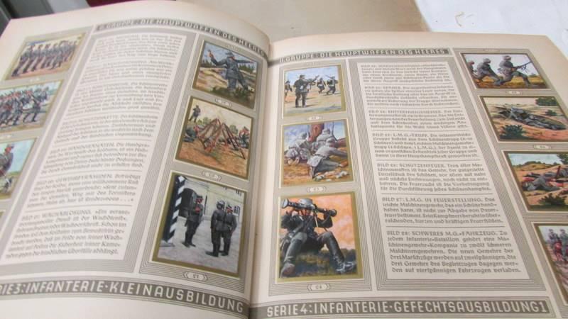 A 1933 'Die Reichswehr' German military cigarette card album, complete. - Image 3 of 10