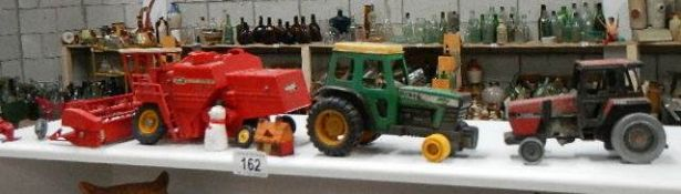 A quantity of toy tractors.