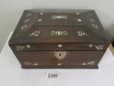 A mother of pear inlaid needlework box (missing one handle from side otherwise in good condition).