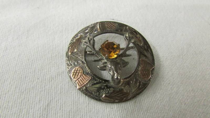 A silver thistle brooch and three silver rings. - Image 2 of 5