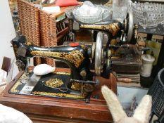 Two vintage Singer sewing machines.