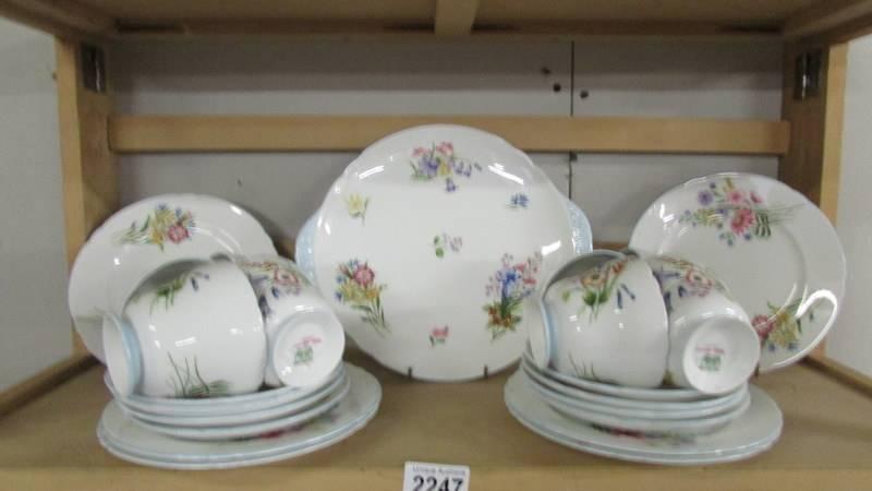 A Shelley tea set comprising teapot, sugar bowl, milk jug, 12 tea cups, 12 saucers, - Image 3 of 5