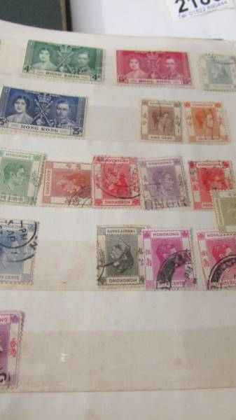 Two small albums of world stamps including India, China, Canada, UK etc. - Image 10 of 14