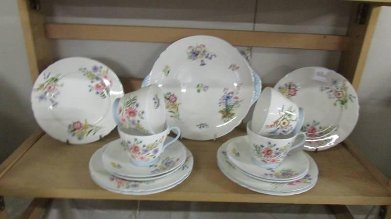 A Shelley tea set comprising teapot, sugar bowl, milk jug, 12 tea cups, 12 saucers, - Image 4 of 5
