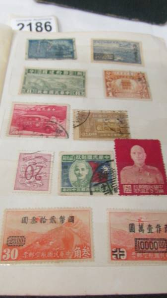 Two small albums of world stamps including India, China, Canada, UK etc. - Image 7 of 14