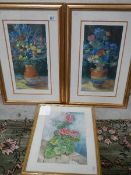 Two good prints of flowers and a watercolour.