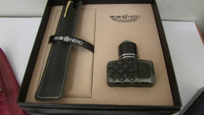 2 letter openers, a quill pen and a 'Hero' pen and ink gift set. - Image 2 of 4