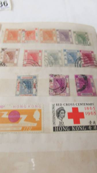 Two small albums of world stamps including India, China, Canada, UK etc. - Image 11 of 14