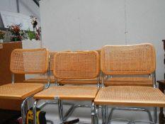 Six good wicker chairs.