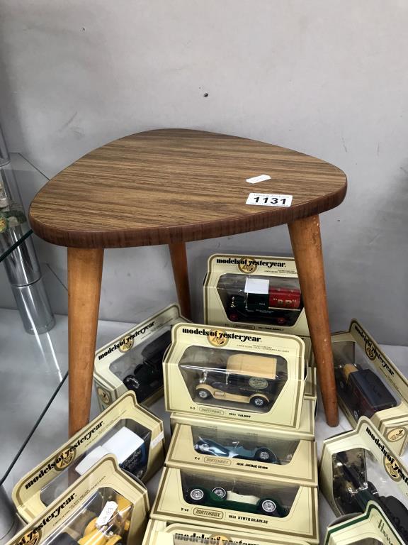 A 1970's retro tripod teak effect side table
