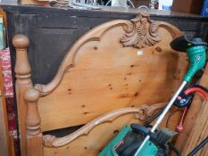 A good pine bedstead complete with side rails and slats.