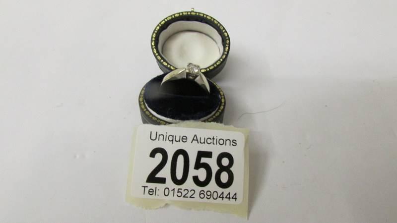 A single stone diamond ring in 9ct gold, size L half.