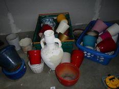 A large quantity of garden pots.