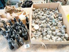 20 small black bottles,