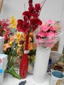 A quantity of artificial flowers in baskets.