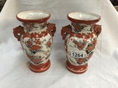 A pair of 19th century Japanese Kutani hand painted vases