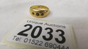 A 22ct gold ring set 3 rubies (6.8 grams).