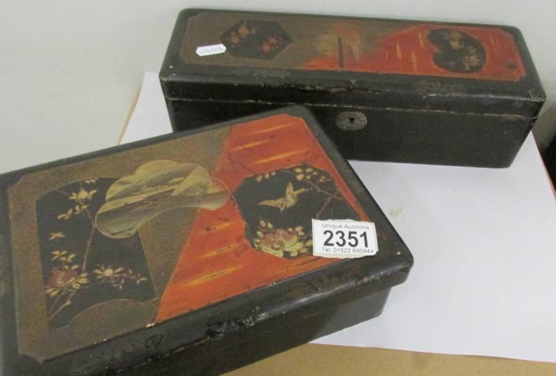 Two Japanese lacquered boxes.