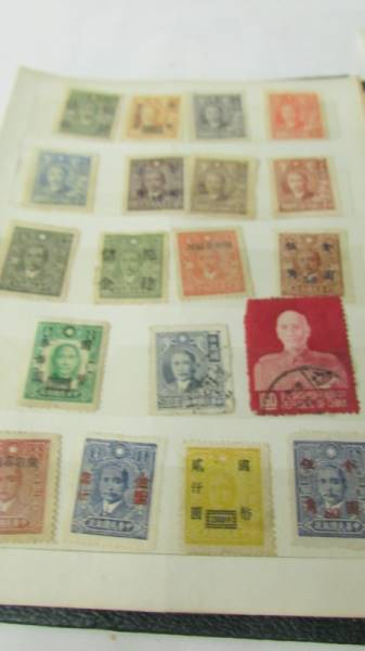 Two small albums of world stamps including India, China, Canada, UK etc. - Image 3 of 14