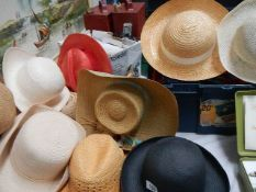A mixed lot of vintage straw and other hats.