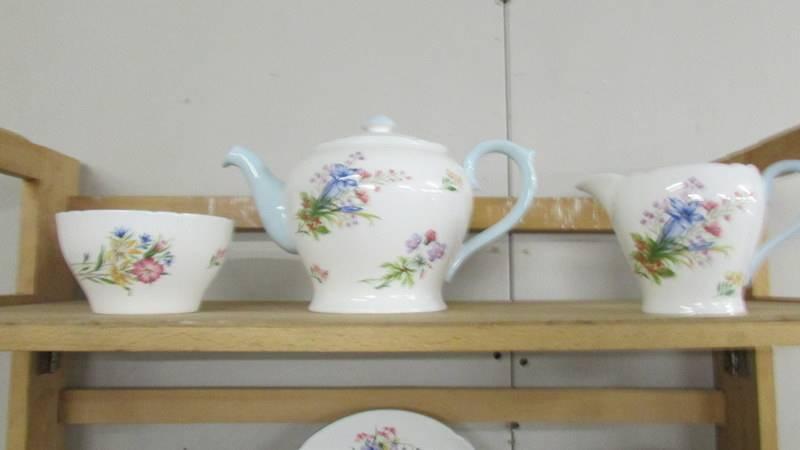 A Shelley tea set comprising teapot, sugar bowl, milk jug, 12 tea cups, 12 saucers, - Image 2 of 5