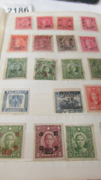Two small albums of world stamps including India, China, Canada, UK etc. - Image 4 of 14