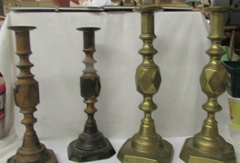 Two pairs of Victorian brass candlesticks - 'King of Diamonds' and 'The Diamond Princess'.