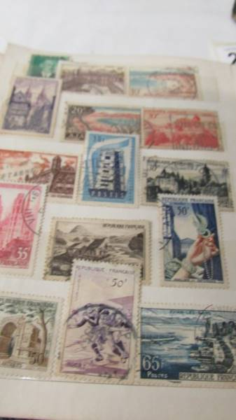 Two small albums of world stamps including India, China, Canada, UK etc. - Image 8 of 14