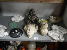 A shelf of garden figures.