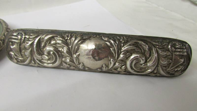 A silver backed hand mirror and two silver backed brushes, (one brush a/f). - Image 7 of 8