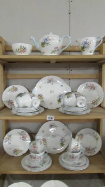 A Shelley tea set comprising teapot, sugar bowl, milk jug, 12 tea cups, 12 saucers,