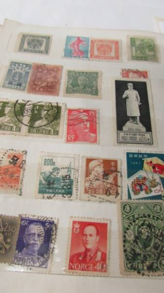 Two small albums of world stamps including India, China, Canada, UK etc. - Image 6 of 14
