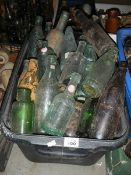 A box of glass advertising bottles. in need of a good clean.