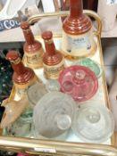 10 glass jar tops & 4 Bells whisky bells (empty)