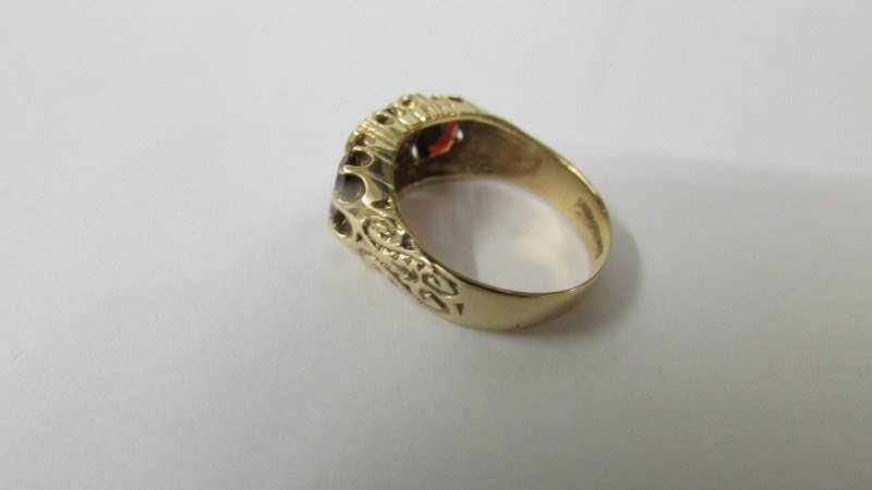 A 9ct gold ring set red stones and diamonds, size Q, 4 grams total. - Image 3 of 3