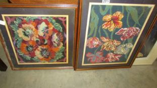 Two framed and glazed floral tapestries.
