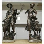 A pair of large spelter figures of shepherd and shepherdess on marble bases.