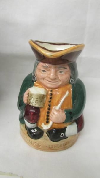 A Royal Doulton traditional Toby Jug The Huntsman and a smaller example Honest Measure. - Image 4 of 5